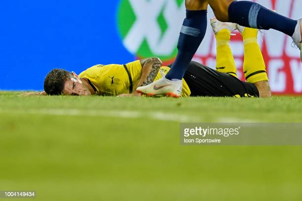 Borussia Dortmund midfielder Christian Pulisic lays on the ground after being tipped by Manchester City defender Oleksandr Zinchenko during an...