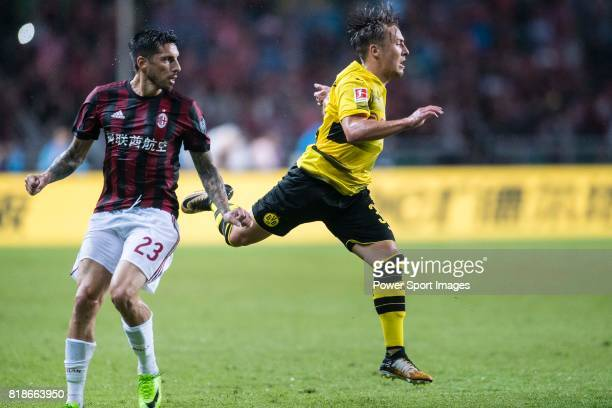 Borussia Dortmund Midfielder Felix Passlack fights for the ball with AC Milan Midfielder Jose Sosa during the International Champions Cup 2017 match...