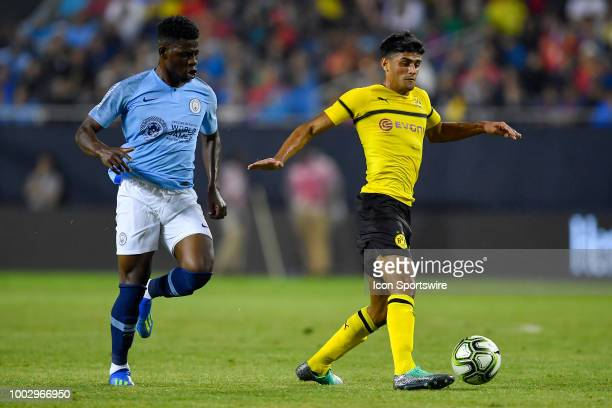 Borussia Dortmund midfielder Mahmoud Dahoud handles the ball against Manchester City midfielder Tom DeleBashiru and on July 20 2018 at Soldier Field...