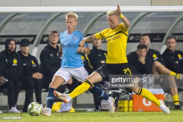 Borussia Dortmund midfielder Marius Wolf battles for the ball against Manchester City FC defender Oleksandr Zinchenko during an International...