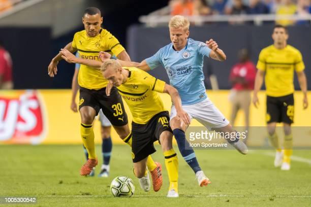 Borussia Dortmund midfielder Sebastian Rode battles Manchester City FC defender Oleksandr Zinchenko during an International Champions Cup match on...