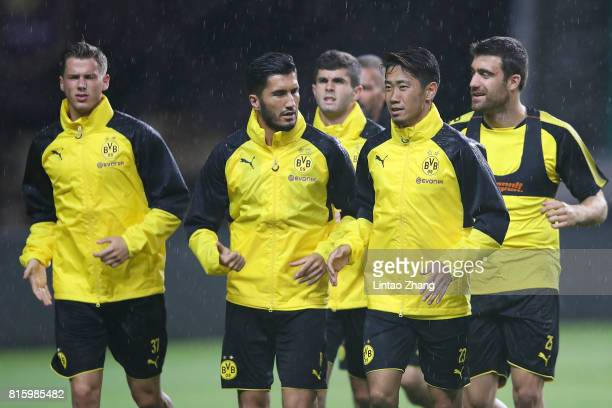 Borussia Dortmund player Shinji Kagawa with Nuri Sahin in action duirng training session ahead of the 2017 International Champions Cup football match...