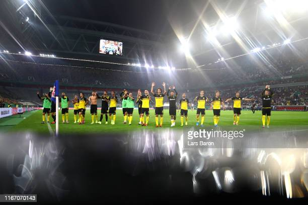 Borussia Dortmund players acknowledge their fans as they celebrate victory after the DFB Cup first round match between KFC Uerdingen and Borussia...