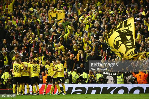 Borussia Dortmund players and fans celebrate the third goal scored by Marco Reus during the UEFA Europa League quarter final second leg match between...