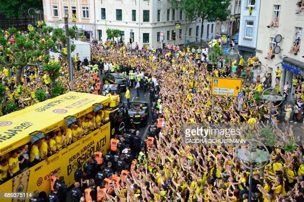 BVB Borussia Dortmund players arrive at Borsigplatz during celebrations after winning the German Cup final in Dortmund western Germany on May 28 2017...