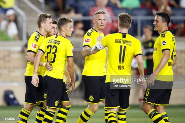 Borussia Dortmund players celebrate after a goal against Liverpool FC in the second half of the preseason friendly match at Notre Dame Stadium on...