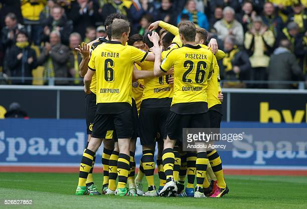 Borussia Dortmund' players celebrate after a goal during their Bundesliga soccer match between Borussia Dortmund and VfL Wolfsburg at the SignalIduna...