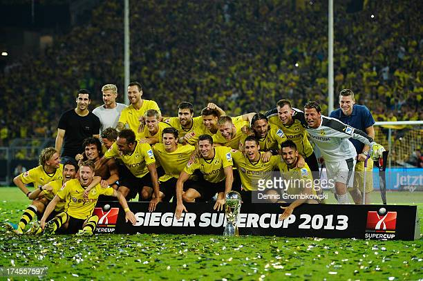 Borussia Dortmund players celebrate after winning the DFL Supercup match between Borussia Dortmund and FC Bayern Muenchen at Signal Iduna Park on...