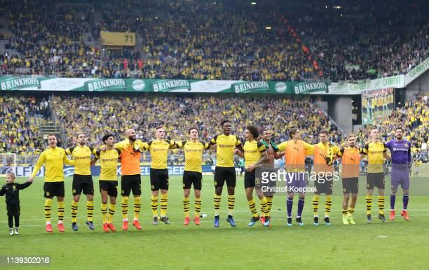 Borussia Dortmund players celebrate following the Bundesliga match between Borussia Dortmund and VfL Wolfsburg at Signal Iduna Park on March 30, 2019...