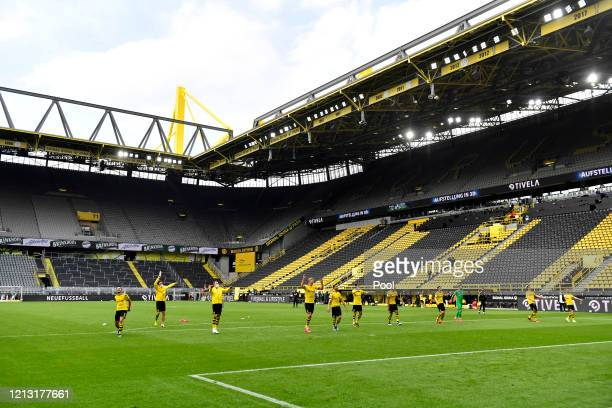 Borussia Dortmund players celebrate following the Bundesliga match between Borussia Dortmund and FC Schalke 04 at Signal Iduna Park on May 16 2020 in...