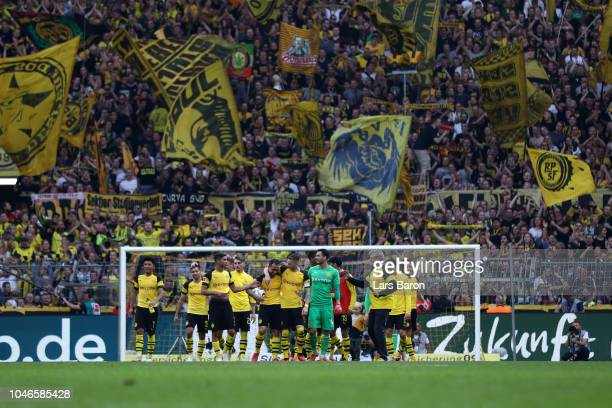Borussia Dortmund players celebrate following their sides victory in during the Bundesliga match between Borussia Dortmund and FC Augsburg at Signal...