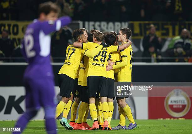 Borussia Dortmund players celebrate their team's second goal during the UEFA Europa League round of 32 first leg match between Borussia Dortmund and...