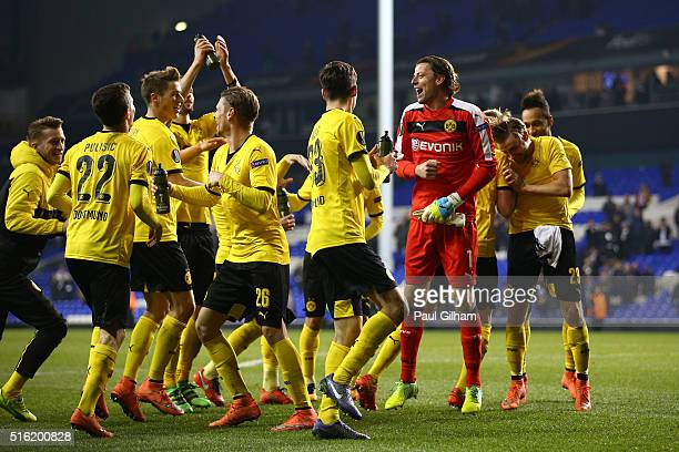 Borussia Dortmund players celebrate victory with their fans after the UEFA Europa League round of 16 second leg match between Tottenham Hotspur and...