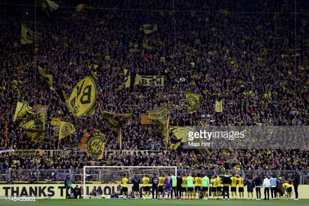 Borussia Dortmund players celebrate with fans following the Bundesliga match between Borussia Dortmund and Fortuna Duesseldorf at Signal Iduna Park...