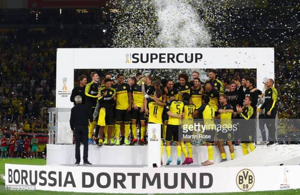 Borussia Dortmund players celebrate with the DFL Supercup Trophy following their team's victory in the DFL Supercup 2019 match between Borussia...