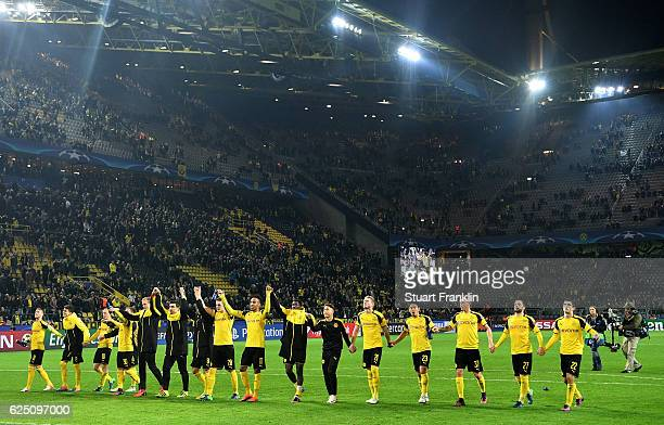 Borussia Dortmund players celebrate with their fans after the UEFA Champions League Group F match between Borussia Dortmund and Legia Warszawa at...