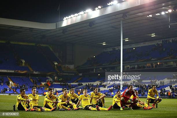 Borussia Dortmund players look on in victory after the UEFA Europa League round of 16 second leg match between Tottenham Hotspur and Borussia...