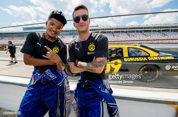 Borussia Dortmund players Marco Reus and Jadon Sancho visit a racetrack in Charlotte In which they drive in a Nascar test rounds On Charlotte Motor...