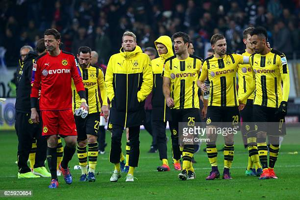 Borussia Dortmund players show their dejection after their 12 defeat in the Bundesliga match between Eintracht Frankfurt and Borussia Dortmund at...