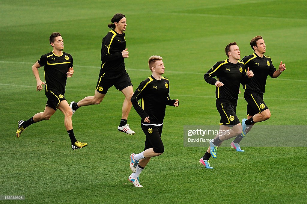 Borussia Dortmund players warm up during training session ahead of the UEFA Champions League quarter-final first leg match against Malaga CF at La Rosaleda Stadium on April 2, 2013 in Malaga, Spain.