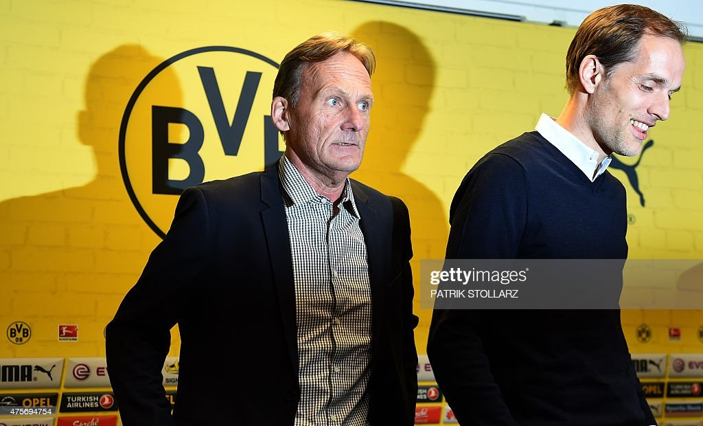 Borussia Dortmund ´s CEO Hans-Guenther Watzke (L) and new coach Thomas Tuchel attend a press conference of first division Bundesliga football club Borussia Dortmund in the Signal Iduna Park stadium in Dortmund, western Germany on June 3, 2015.