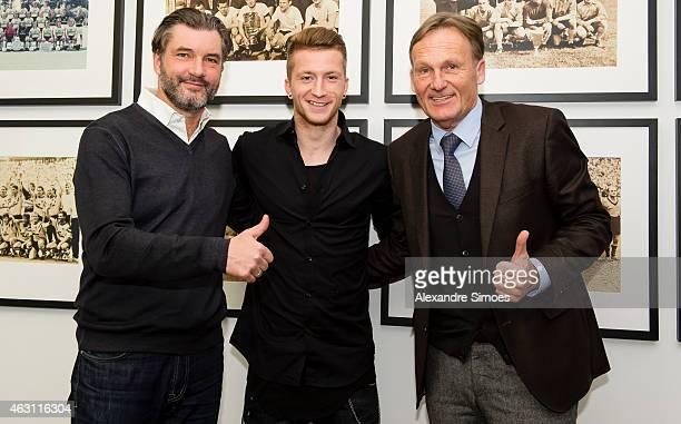 Borussia Dortmund Sports Director Michael Zorc Marco Reus of Borussia Dortmund and Borussia Dortmund CEO HansJoachim Watzke pose after Marco Reus...