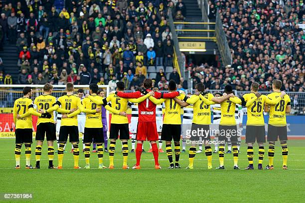 Borussia Dortmund stand for a minutes silence for the Chapecoense football club after the plane crash tradgedy before the Bundesliga match between...