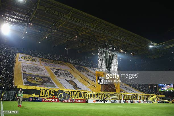 Borussia Dortmund supporters cheer prior to the UEFA Europa League round of 32 first leg match between Borussia Dortmund and FC Porto at Signal Iduna...