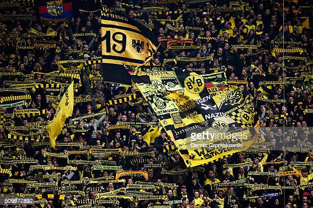 Borussia Dortmund supporters show their support prior to kickoff during the Bundesliga match between Borussia Dortmund and Hannover 96 at Signal...