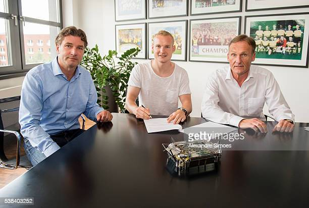 Borussia Dortmund unveils new signing Sebastian Rode with HansJoachim Watzke r and Michael Zorc on June 6 2016 in Dortmund Germany