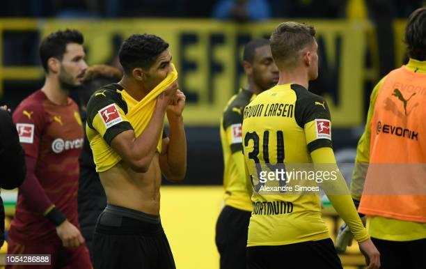 Borussia Dortmund's Achraf Hakimi and Jacob Bruun Larsen reacts after the Bundesliga match between Borussia Dortmund and Hertha BSC at the Signal...