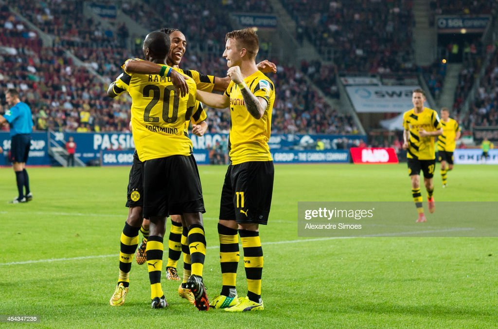 Borussia Dortmund's Adrian Ramos celebrates scoring a goal to make it 3-0 together with his team mates Marco Reus and Pierre-Emerick Aubameyang during the Bundesliga match between FC Augsburg and Borussia Dortmund at SGL Arena on AUGUST 29, 2014 in Dortmund, Germany.