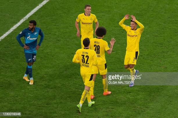 Borussia Dortmund's Belgian midfielder Axel Witsel celebrates with teammates after scoring the team's second goal during the UEFA Champions League...