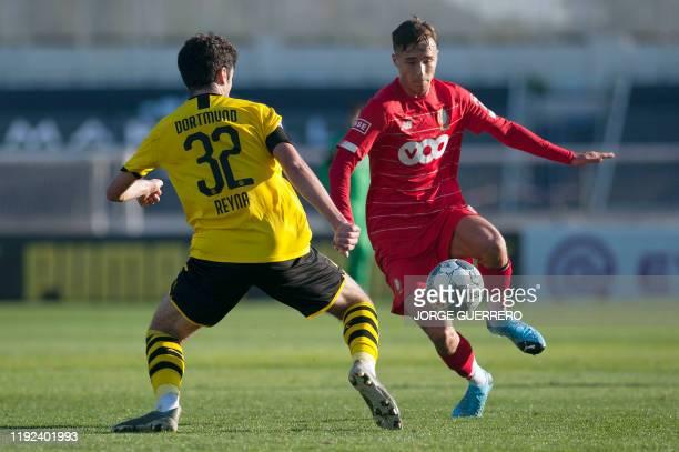 Borussia Dortmund's British midfielder Giovanni Reyna vies with Standard Liege's Belgian midfielder Joachim Carcela Gonzalez during the friendly...
