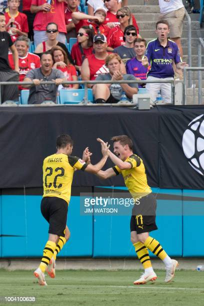 Borussia Dortmund's Christian Pulisic celebrates his second goal with teammate Sergio Gomez during the 2018 International Champions Cup match against...