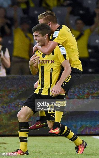 Borussia Dortmund's Christian Pulisic celebrates with a teammate after scoring against Manchester City during the 2016 International Champions Cup...