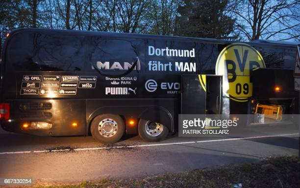 Borussia Dortmund's damaged bus is pictured after an explosion some 10km away from the stadium prior to the UEFA Champions League 1st leg...