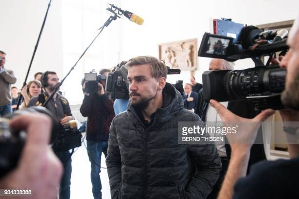 Borussia Dortmund's defender Marcel Schmelzer arrives for a hearing as a witness in the trial on a bomb attack on the team bus of German first...