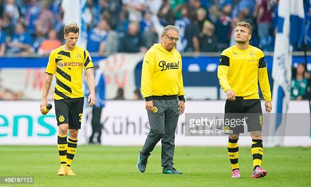 Borussia Dortmund's Erik Durm team manager Fritz Luenschermann and Ciro Immobile look dejected after the Bundesliga match between FC Schalke 04 and...