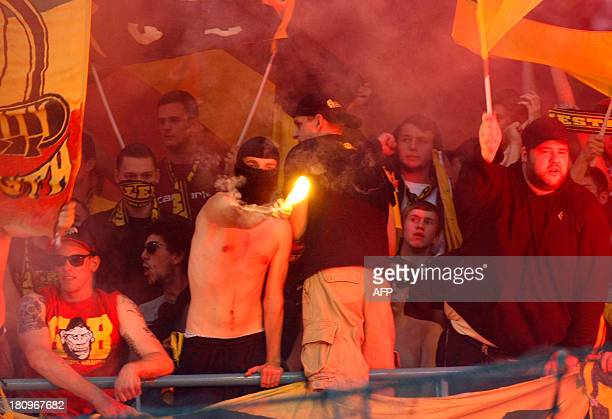 Borussia Dortmund's fans throw fireworks during the group F Champions League football match SSC Napoli vs Borussia Dortmund on September 18 2013 at...