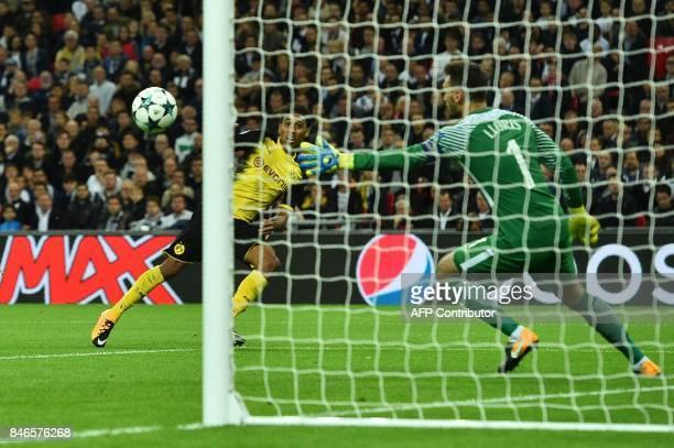 Borussia Dortmund's Gabonese striker PierreEmerick Aubameyang scores a disallowed goal past Tottenham Hotspur's French goalkeeper Hugo Lloris during...