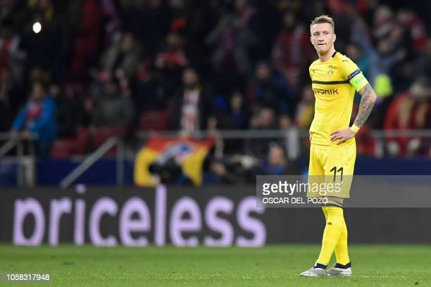 Borussia Dortmund's German forward Marco Reus reacts to Atletico's second goal during the UEFA Champions League group A football match between Club...
