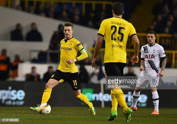 Borussia Dortmund's German striker Marco Reus runs with the ball during the UEFA Europa League round of 16 second leg football match between...