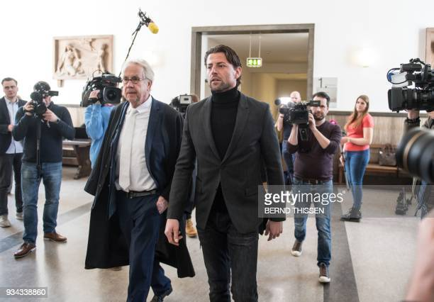 Borussia Dortmund's goalkeeper Roman Weidenfeller together with lawyer Alfons Becker arrives for a hearing as a witness in the trial on a bomb attack...