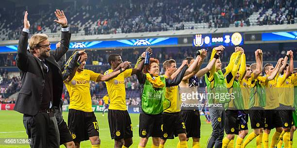 Borussia Dortmund's head coach Juergen Klopp celebrates with PierreEmerick Aubameyang Adrian Ramos and the rest his players after the final whistle...