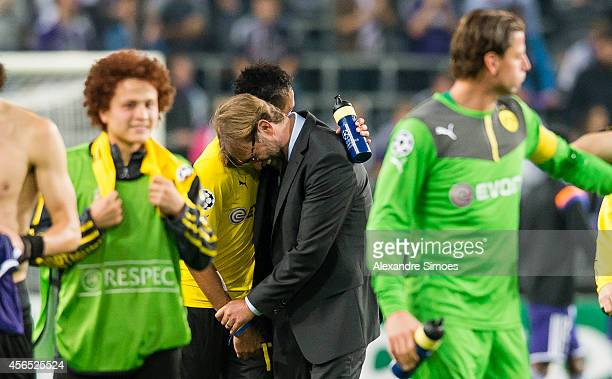 Borussia Dortmund's head coach Juergen Klopp celebrates with his player PierreEmerick Aubameyang after the final whistle during the UEFA Champions...