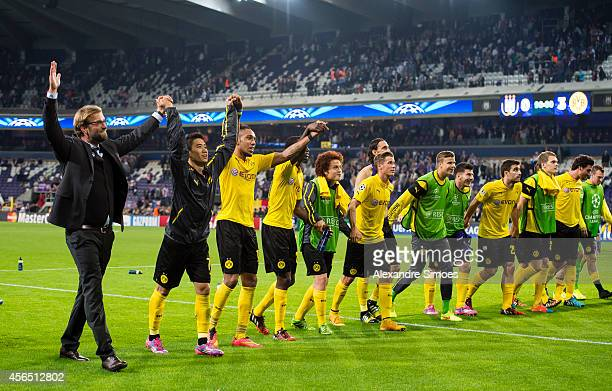 Borussia Dortmund's head coach Juergen Klopp celebrates with Shinji Kagawa PierreEmerick Aubameyang and the rest his players after the final whistle...