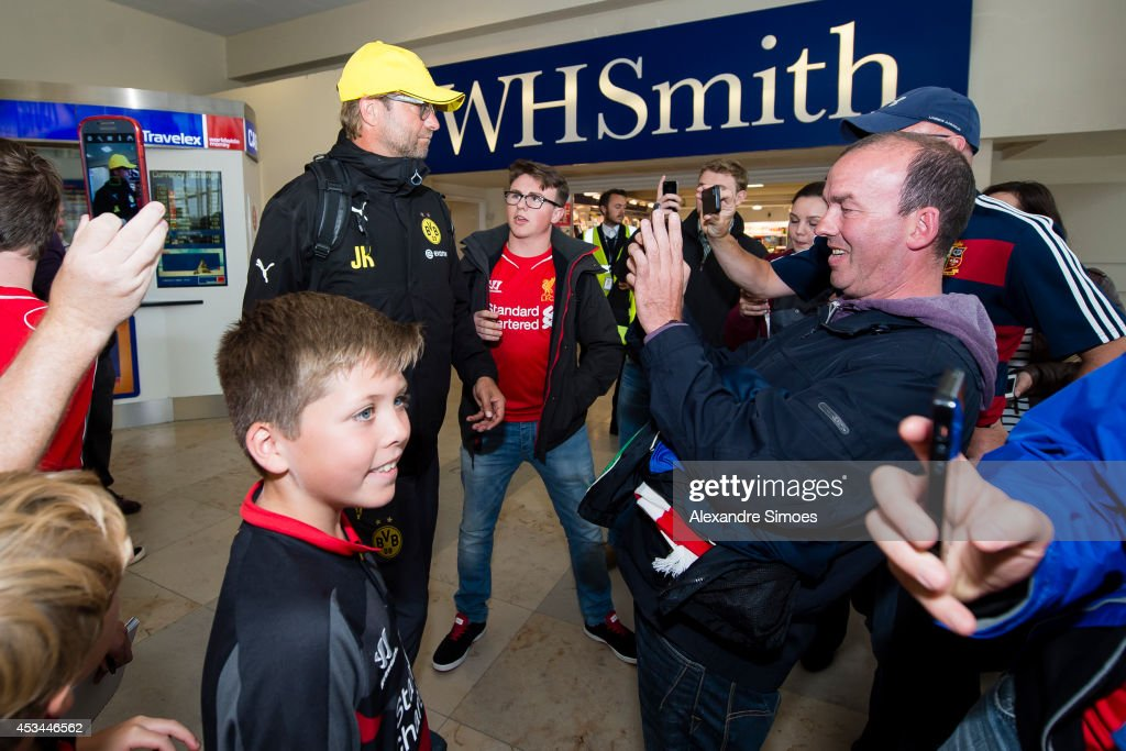 Borussia Dortmund's head coach Juergen Klopp is giving autographs at the airport before the pre season friendly match between Liverpool FC and Borussia Dortmund at Anfield on August 10, 2014 in Liverpool, England.