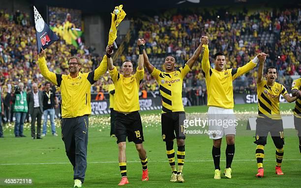 R Borussia Dortmund's head coach Juergen Klopp Kevin Grosskreuz Aubameyang Milos Jojic and Henrikh Mkhitaryan celebrate after the DFL Supercup 2014...