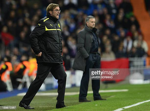 Borussia Dortmund's head coach Juergen Klopp reacts close to Real Madrid's Portuguese coach Jose Mourinho during the UEFA Champions League football...